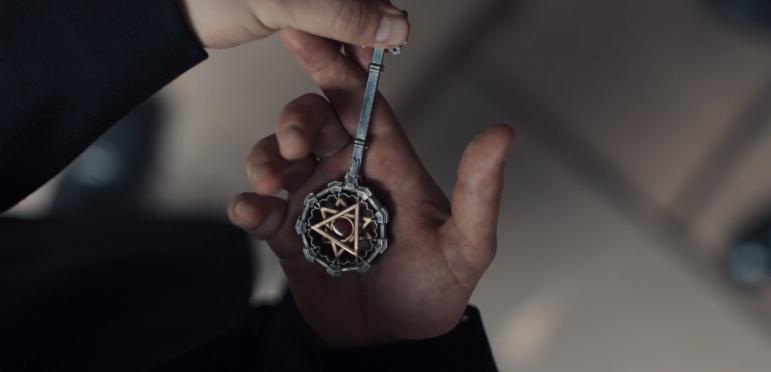 Baldwin holding the vampire key.